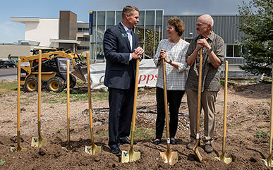 LCCC President Dr. Joe Schaffer speaks with Dr. Sandra Surbrugg and her husband Dr. Bob Prentice at the groundbreaking ceremony for the Surbrugg Prentice Auditorium; the facility is scheduled to open this winter.