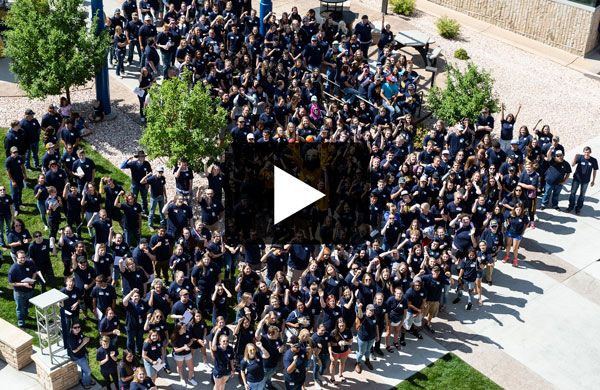 overhead view of crowd of students on LCCC campus with video play button
